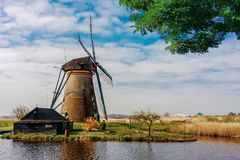 Beautiful dutch windmill house lands. Beautiful windmill landscape at kinderdijk in the netherlands Royalty Free Stock Photography