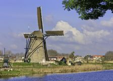 Beautiful dutch windmill house lands. Beautiful windmill landscape at kinderdijk in the netherlands Royalty Free Stock Photo