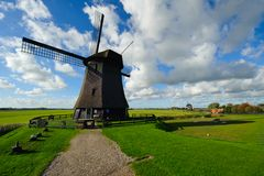 Beautiful windmill landscape in the Netherlands. Schermerhorn, Schermer, Noord-Holland Royalty Free Stock Image