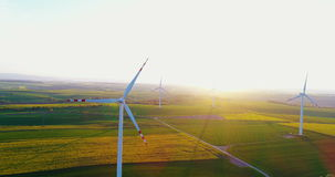 Beautiful windmill turbines , wind energy turbines at sunset. Windmill and Wind power technology background. Aerial view on Wind Power, Turbine, Windmill stock video
