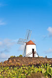 Beautiful windmill under blue sky in lanzarote Royalty Free Stock Image