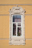 Beautiful window. Beautiful carved wooden houses in Tomsk, Russia Stock Image