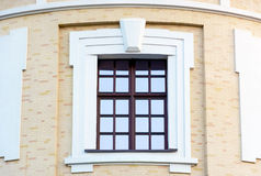 Beautiful window on the brick wall. Stock Photos
