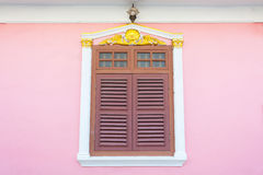 Beautiful window on pink wall in Sino Portuguese style at Soi Ro. A beautiful window on pink wall in Sino Portuguese style at Soi Rommanee, Phuket, Thailand Royalty Free Stock Photography