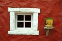 Beautiful window in red wall Royalty Free Stock Photos