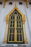 The beautiful window of the temple. The golden color of Thai famous temple Wat Sothorn and the blue sky Royalty Free Stock Photography