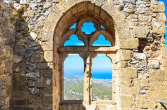 Beautiful window view from ancient St. Hilarion Castle in Northern Cyprus. The amazing view point offers a beautiful view. Over Cypriot Kyrenia region and stock photography