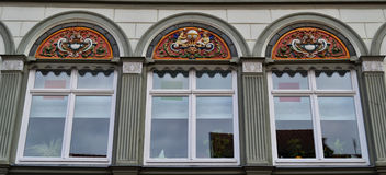 Beautiful Windows in Muehlhausen, Germany. A row of lovely ornamental windows Muehlhausen, Germany Royalty Free Stock Image