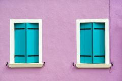 Free Beautiful Windows With Turquoise Shutters On Purple White Wall. Colorful Houses On Burano Island Near Venice, Italy Royalty Free Stock Photos - 159173838