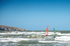 Beautiful Windsurfing on the sea during a storm stock images