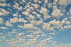 Beautiful windy clouds on a blue sky in a summer sunny day. stock photo