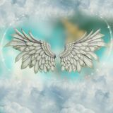 Wings in the sky with stars royalty free stock photo