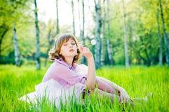 Beautiful Winking Girl With Dandelion Stock Photo