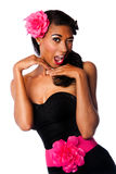 Beautiful winking pinup girl. Beautiful pinup girl with pink flowers and black corset winking playfully, isolated stock image