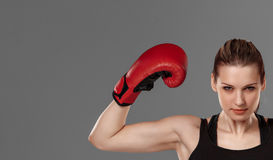 Beautiful winner. Blond hair woman in red boxing Stock Image