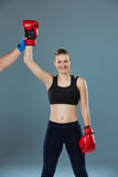 Beautiful winner. Blond hair woman in red boxing Royalty Free Stock Images