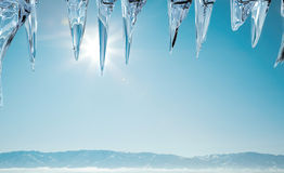 Beautiful winter. Winter landscape with sun and icicles Stock Photo
