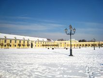 Pretty winter atmosphere with an austrian building in vienna next to the castle covered with snow royalty free stock photography