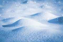 Beautiful winter background of snow drifts and falling snow.  royalty free stock photo