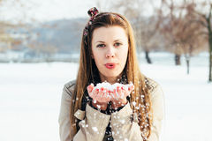 Beautiful winter blonde blowing snow Royalty Free Stock Images