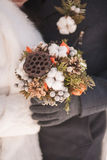 Beautiful winter bridal wedding bouquet in hands Stock Photo