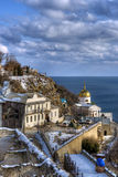 Beautiful winter church. Beautiful church over sea cliff Stock Photos