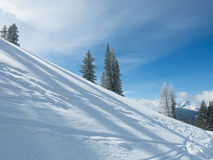 Beautiful winter day at a ski resort. Beautiful winter day on mountains Stock Photos