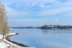 Beautiful winter day. Snow on the bank of the river. Stock Photos