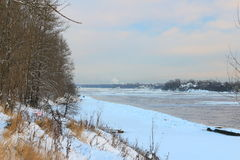 Beautiful winter day. Snow on the bank of the river. Stock Image