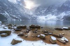 Eye of the Sea lake in Tatra mountains at winter. Beautiful winter at Eye of the Sea lake in in Tatra mountains, Poland Stock Photos
