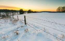 Beautiful winter fields with barbed wire fence Royalty Free Stock Images