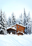Beautiful winter forest and romantic wooden house Stock Photos
