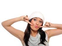 Beautiful winter girl in a hat having fun Stock Images