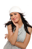 Beautiful winter girl in a hat smiling Royalty Free Stock Photography