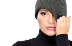 Beautiful Winter Girl Hiding Eye with Cap. Spy Royalty Free Stock Image