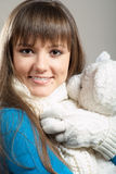 Beautiful winter girl with teddy Royalty Free Stock Photography