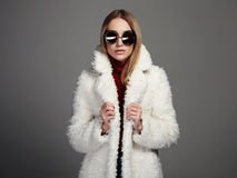 Beautiful winter girl in white fur and sunglasses. winter woman Royalty Free Stock Photos