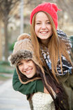 Beautiful winter girls with woolen caps Stock Images