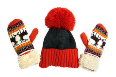 Beautiful winter hat and mittens with deer isolated on white background Stock Photo