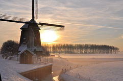 Beautiful winter in Holland. Windmill in winter in holland with a beautiful sky Royalty Free Stock Photography