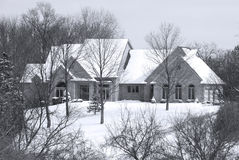 Beautiful Winter Home in a Secluded Country Setting. Beautiful Home in a Secluded Country Setting - a brick home sits in a secluded wooded country setting on a Stock Photography
