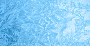 Beautiful winter ice, blue texture on window, festive background