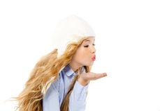 Beautiful winter kid girl blowing wind with lips. Isolated on white Stock Photos