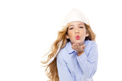 Beautiful winter kid girl blowing wind with lips Royalty Free Stock Photo