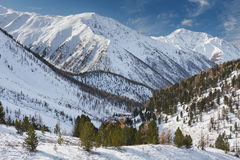 Beautiful winter landscape, Altai mountains Russia. Winter landscape. Dramatic overcast sky.Severe mountains peaks covered by snow. Russia, Siberia, Altai Royalty Free Stock Image