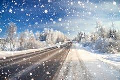 Winter landscape with asphalt road,forest and blue sky. Stock Images