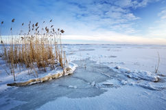 Beautiful winter landscape with frozen lake. Royalty Free Stock Images