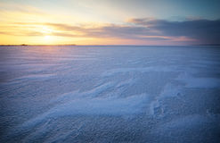 Beautiful winter landscape with frozen lake and sunset sky. Stock Photography