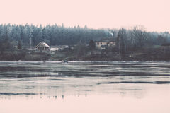 Beautiful winter landscape with frozen lake. vintage Stock Photos