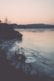 Beautiful winter landscape with frozen lake. vintage Royalty Free Stock Photo